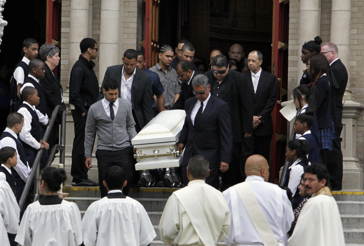 The smallest casket bearing one of seven family members who died in a horrific highway accident is carried from the funeral at the Church of St. Raymond in the Bronx borough of New York, Friday, May 4, 2012, The accident sent their SUV hurling over a guardrail and into a ravine. Killed in Sunday's wreck were Jacob Nunez and Ana Julia Martinez, who were visiting from the Dominican Republic community of Manuel Bueno; their daughters, Maria Gonzalez and Maria Nunez, and three grandchildren. The children were Jocelyn Gonzalez, 10, the daughter of the driver, and Niely Rosario, 7, and Marly Rosario, 3, both daughters of Nunez. (AP Photo/Richard Drew)