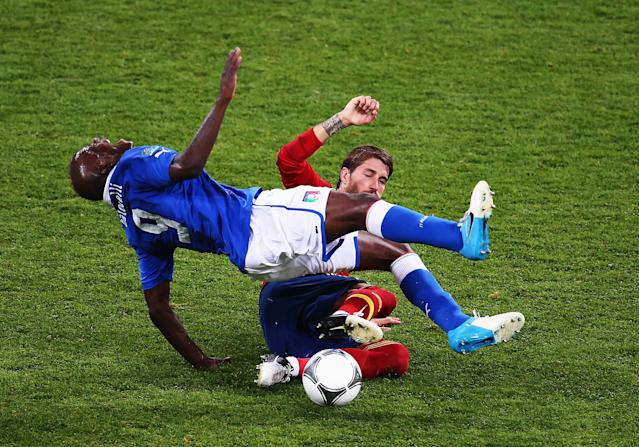 KIEV, UKRAINE - JULY 01: Sergio Ramos of Spain slides in to tackle Mario Balotelli of Italy during the UEFA EURO 2012 final match between Spain and Italy at the Olympic Stadium on July 1, 2012 in Kiev, Ukraine. (Photo by Martin Rose/Getty Images)
