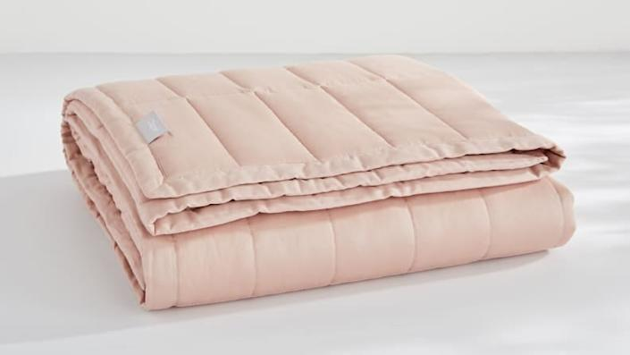 The Casper Weighted Blanket comes in pretty colors like this blush pink.