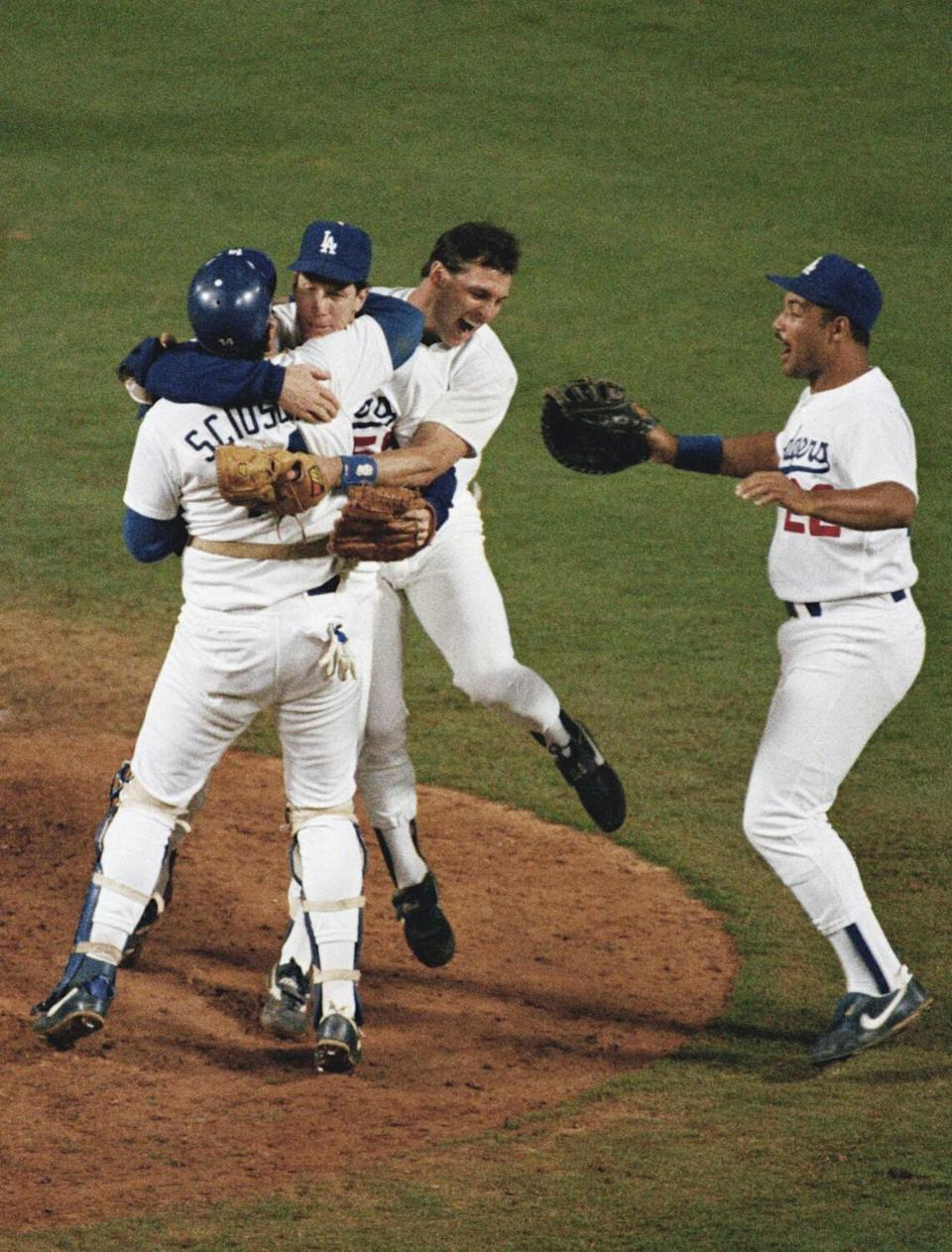 Dodgers pitcher Orel Hershiser, top left, celebrates with catcher Mike Scioscia and teammates Steve Sax and Franklin Stubbs.