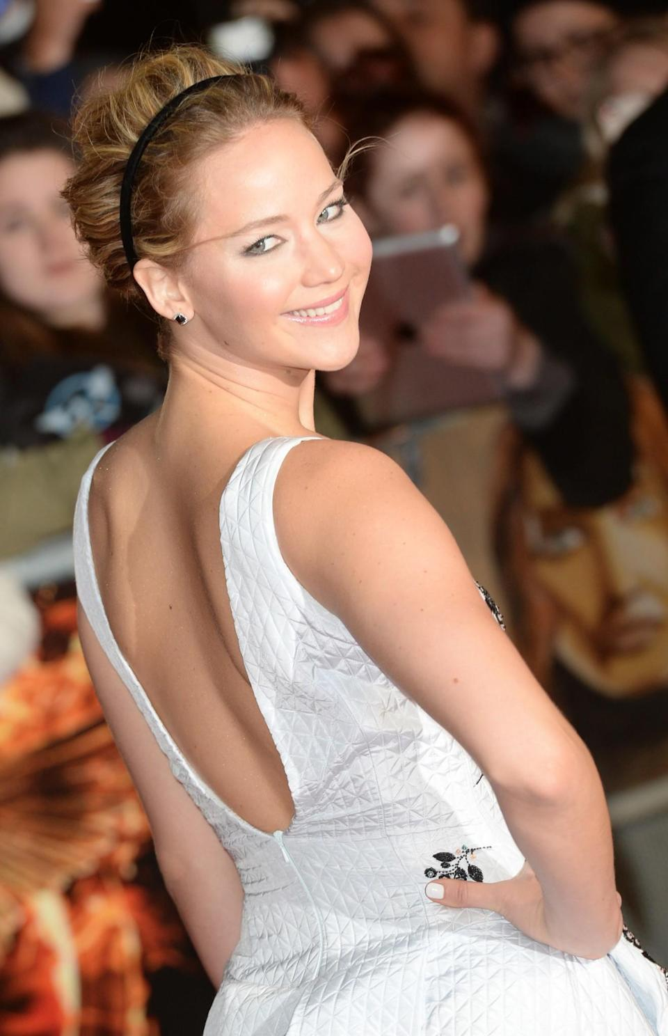 <p>A subtle black hairband was Jennifer's accessory of choice at the UK premiere of 'The Hunger Games: Mockingjay Part 1'. [Photo; Getty] </p>