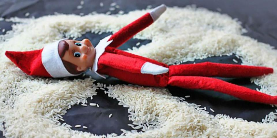 """<p>This elf is making his snow angels out of rice, but you can also use sugar or sprinkles.</p><p><em><a href=""""https://www.lilblueboo.com/2011/12/18-elf-on-the-shelf-ideas-an-elf-sized-photo-shoot.html?pid=132#slideshow"""" rel=""""nofollow noopener"""" target=""""_blank"""" data-ylk=""""slk:See more at Lil Blue Boo »"""" class=""""link rapid-noclick-resp"""">See more at Lil Blue Boo » </a></em></p>"""