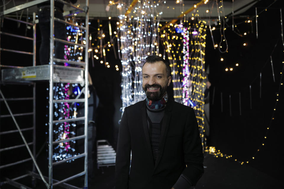 French designer Julien Fournie attends an interview during the shoot for his Haute Couture Spring/Summer 2021 fashion collection for a digital presentation of the fashion week, in Paris, Thursday, Jan. 7, 2021. With shows taking place behind closed doors due to the virus pandemic, some designers such as Julien Fournie are becoming versatile: Getting their designs out to the public by making a film of their collection and streaming it online. (AP Photo/Francois Mori)