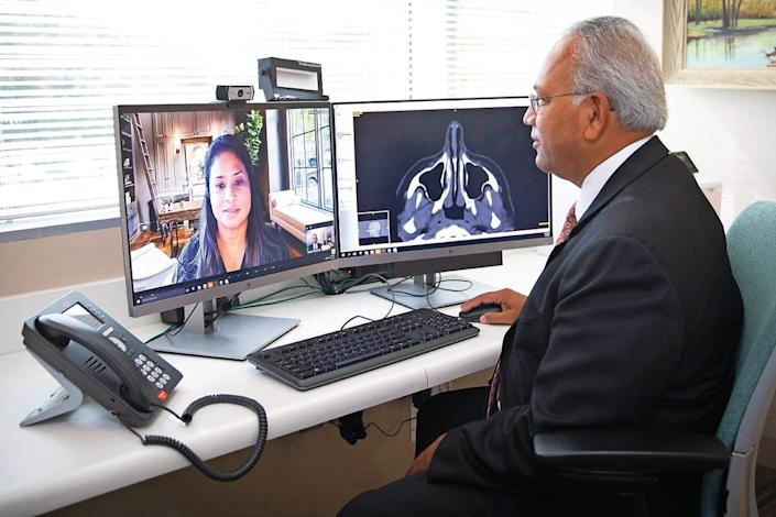 Dr. Sarvam TerKonda of the Mayo Clinic Center for Connected Care consults with a patient.