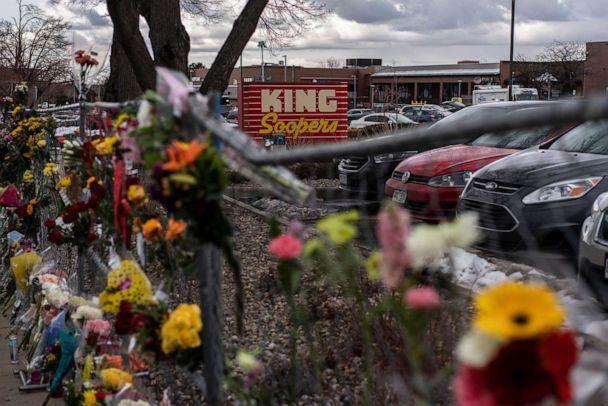 PHOTO: Memorials and flowers are left on the fencing surrounding the grocery store the day after a gunman opened fired at a King Sooper's grocery store, March 22, 2021, in Boulder, Colo. (Chet Strange/Getty Images, FILE)