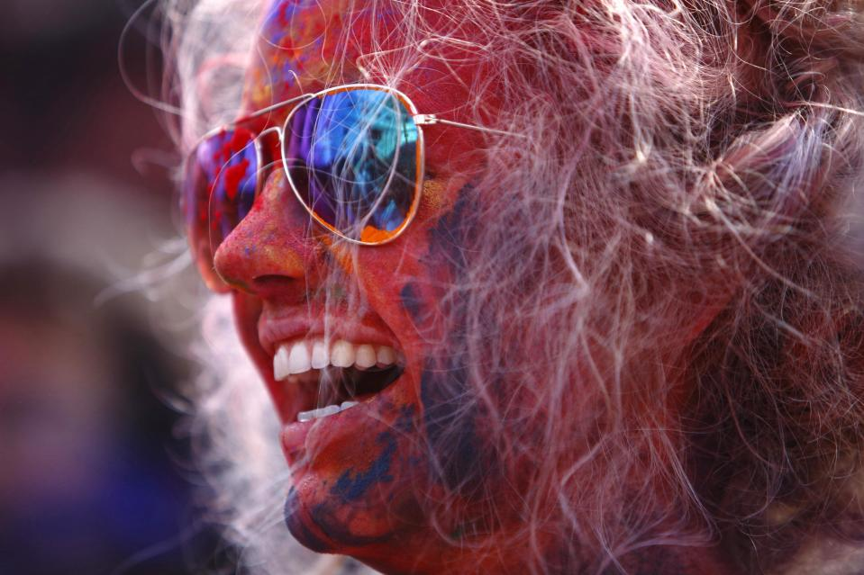A tourist celebrates Holi, the Festival of Colours, in Kathmandu March 16, 2014. Holi marks the beginning of spring and is celebrated with great enthusiasm all over Nepal. REUTERS/Navesh Chitrakar (NEPAL - Tags: RELIGION SOCIETY TRAVEL)