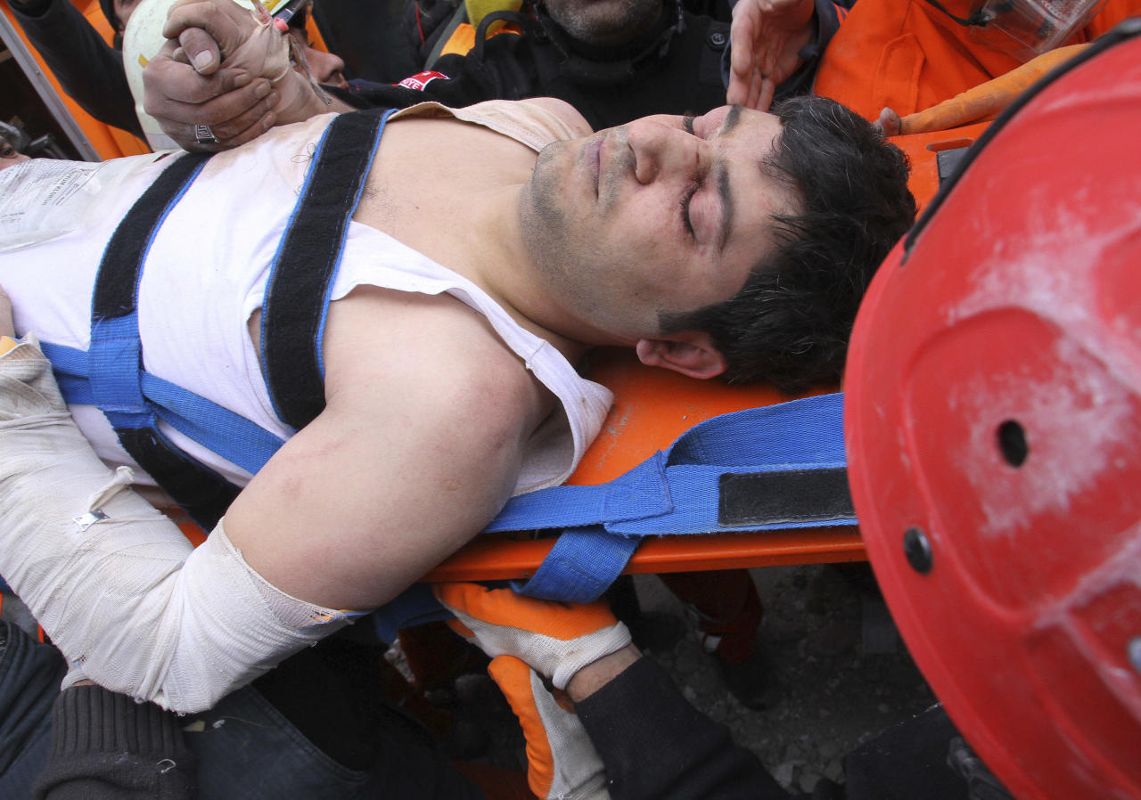 A survivor is carried on a stretcher after rescue workers pulled out him from the rubble of a collapsed hotel in Van, eastern Turkey, early Thursday, Nov. 10, 2011. Rescuers have pulled out 24 survivors from the rubble of three buildings, collapsed by an earthquake in Van, the country's disaster management authority said Thursday. At least seven were killed and dozens of others trapped. The magnitude-5.7 quake was a grim replay of the previous magnitude-7.2 earthquake that hit Oct. 23, killing more than 600 people. (AP Photo)