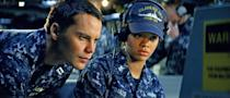 """In this film image provided by Universal Pictures, Taylor Kitsch, left, and Rihanna are shown in a scene from """"Battleship."""" On Saturday, Feb. 23, 2013 at the 33rd Annual Razzie Awards, Rihanna was awarded worst supporting actress for """"Battleship."""" (AP Photo/ILM/Universal Pictures)"""