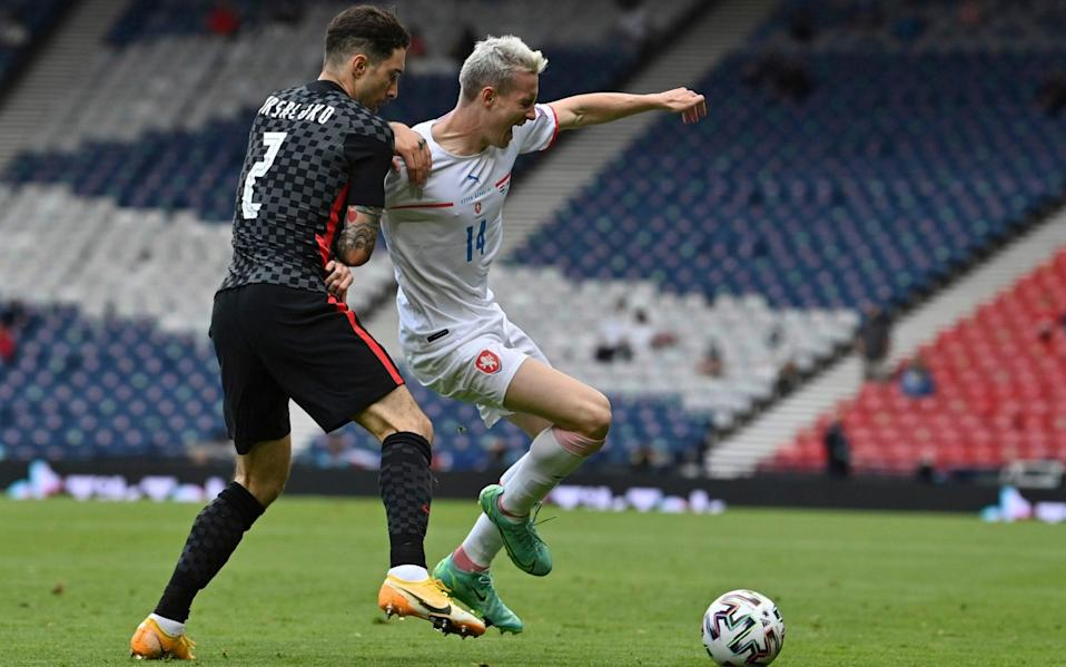 Czech Republic's Jakub Jankto, right, challenges for the ball with Croatia's Sime Vrsaljko during the Euro 2020 soccer championship group D match between Croatia and the Czech Republic at the Hampden Park stadium in Glasgow, Friday, June 18, 2021 - Pool AFP