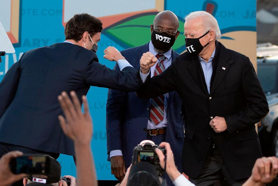 Democrats won back the White House and the Senate thanks to victories by President-elect Joe Biden (right) and Sens.-elect Jon Ossoff (left) and Raphael Warnock (center), but 2020 also showed that the party has plenty of challenges to face. (Photo: JIM WATSON via Getty Images)
