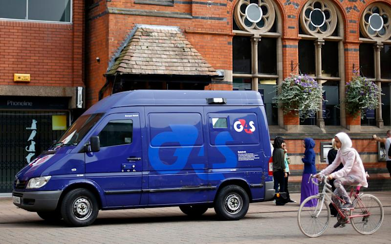 A G4S security van is seen parked outside a bank in Loughborough, central England, August 28, 2013 - Credit: DARREN STAPLES/X90183