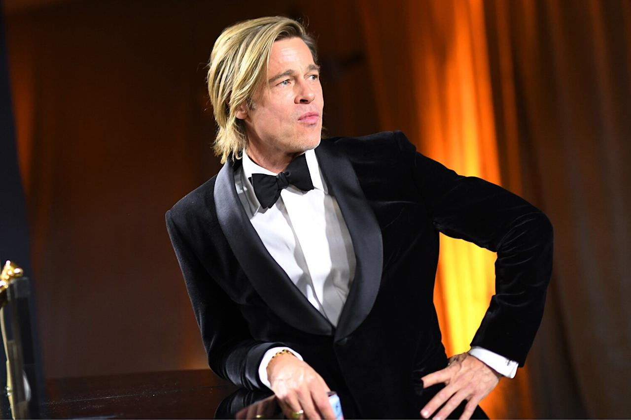 Brad Pitt hangs out by the engraving station at the Governors Ball as he waits for his Best Supporting Actor Oscar to be engraved.