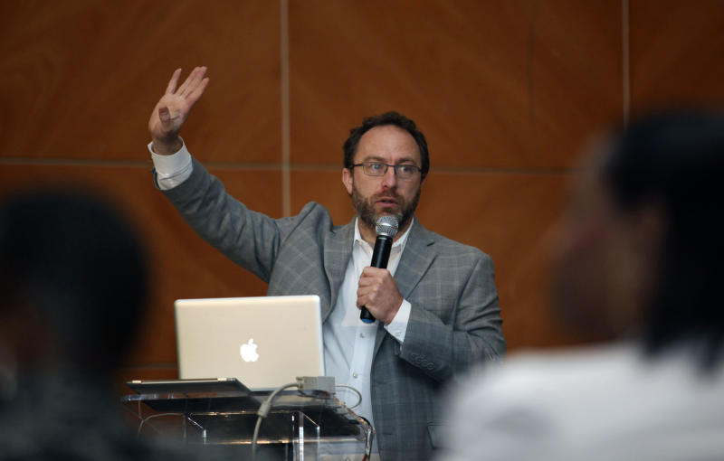 Jimmy Wales, the  founder of Wikipedia speaks during a seminar on youth marketing in Africa in Lagos, Nigeria,Tuesday, March. 27, 2012. The man who helped found Wikipedia says the end of the printing of the Encyclopaedia Britannica signals a new beginning for reference materials online.     (AP Photo/Sunday Alamba)