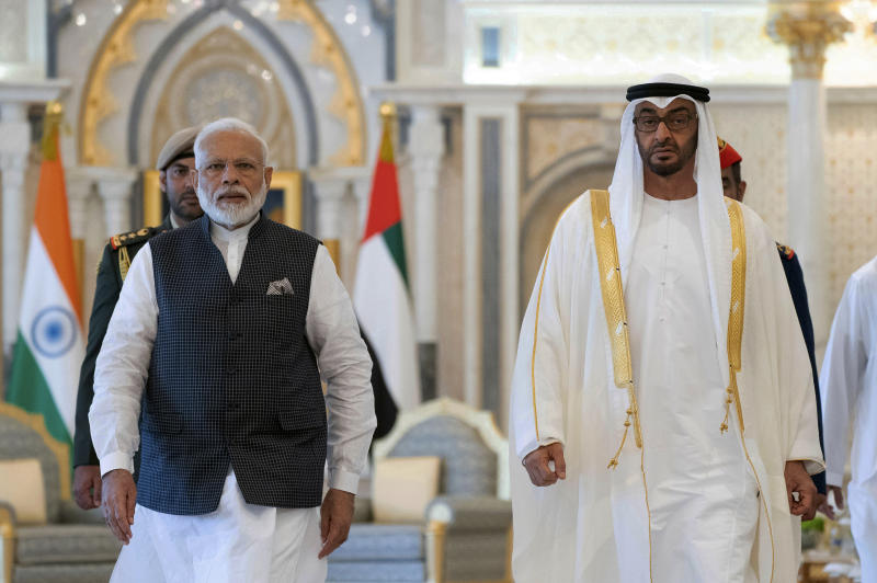 In this photograph made available by the state-run WAM news agency, Indian Prime Minister Narendra Modi, left, walks with Sheikh Mohammed bin Zayed Al Nahyan, right, in Abu Dhabi, United Arab Emirates, Saturday, Aug. 24, 2019. Modi is on a trip to both the United Arab Emirates and Bahrain, reinforcing ties between India and the Gulf Arab nations as he pursues stripping statehood from the disputed Muslim-majority region of Kashmir. (Ryan Carter - Ministry of Presidential Affairs/WAM via AP)