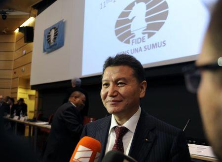 FILE PHOTO: Kirsan Ilyumzhinov smiles after he was re-elected to head the World Chess Federation at the 41st Chess Olympiad in Tromsoe, Norway, August 11, 2014.    REUTERS/Rune Stoltz Bertinussen/NTB Scanpix
