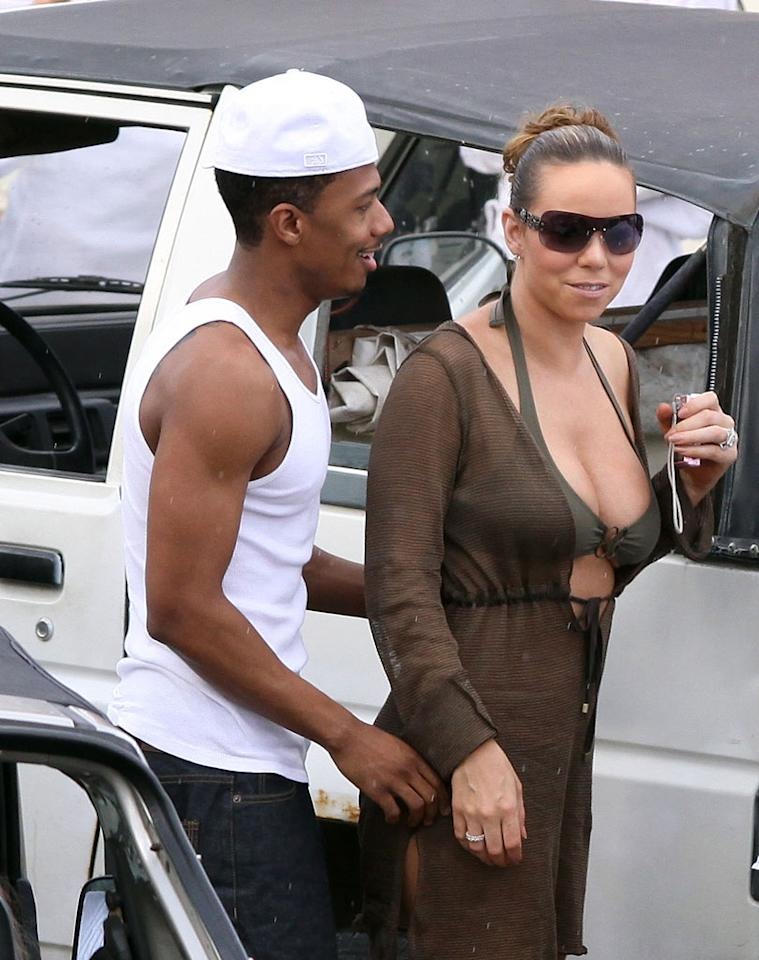 """Mariah Carey quickly dispelled pregnancy rumors after she was spotted drinking wine and eating shellfish while vacationing with husband Nick Cannon in St. Barts. <a href=""""http://www.infdaily.com"""" target=""""new"""">INFDaily.com</a> - December 27, 2008"""