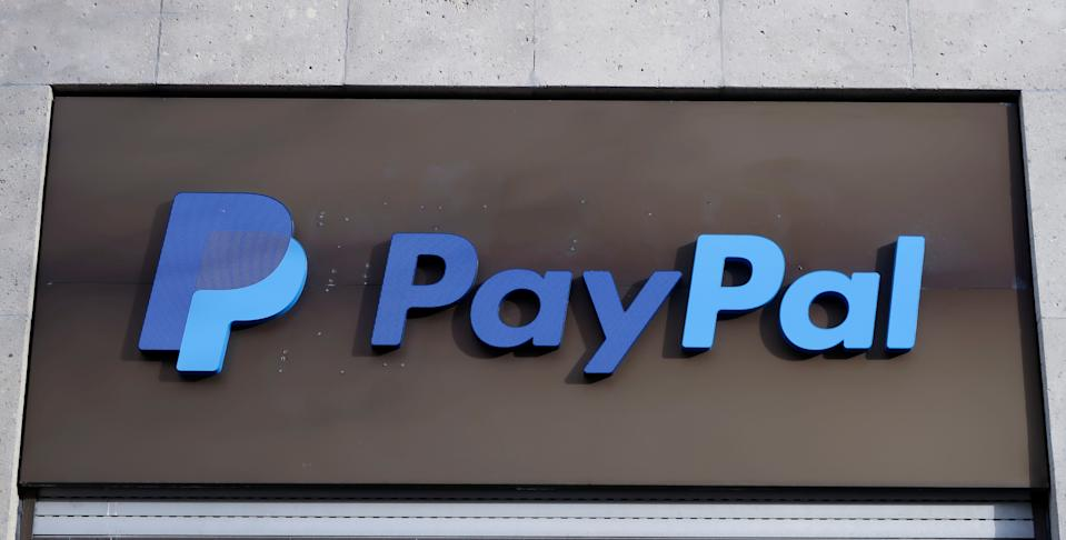 The PayPal logo is seen at an office building in Berlin, Germany, March 5, 2019.   REUTERS/Fabrizio Bensch