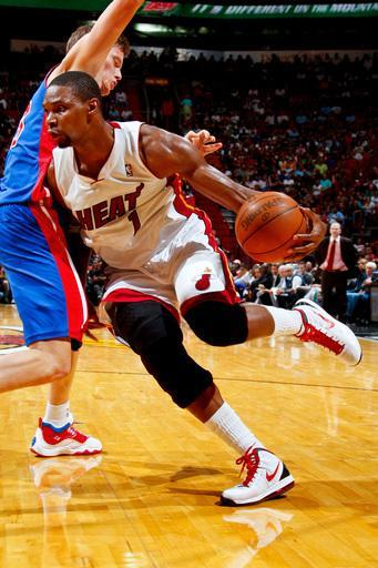 MIAMI, FL - APRIL 8: Chris Bosh #1 of the Miami Heat drives against Jonas Jerebko #33 of the Detroit Pistons on April 8, 2012 at American Airlines Arena in Miami, Florida. (Photo by Issac Baldizon/NBAE via Getty Images)