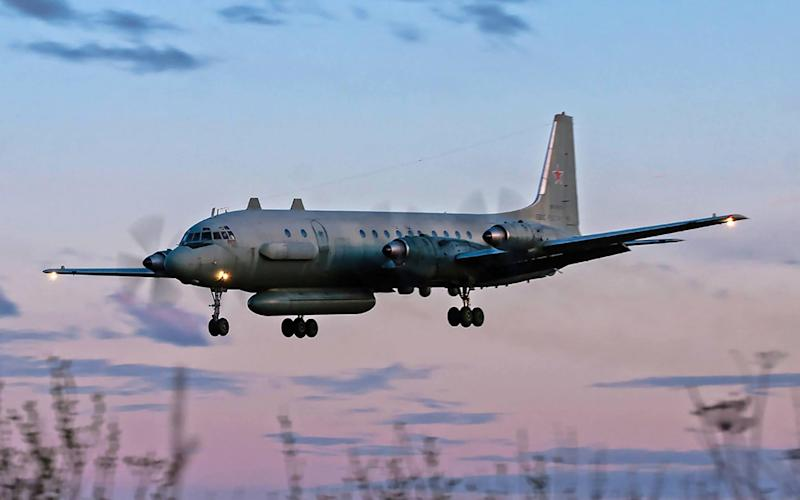 Russian IL-20M (Ilyushin 20m) plane landing at an unknown location.  - AFP