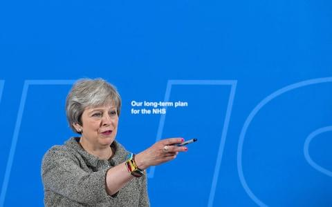 Theresa May unveils her NHS plans - Credit: STEFAN ROUSSEAU/AFP/Getty Images