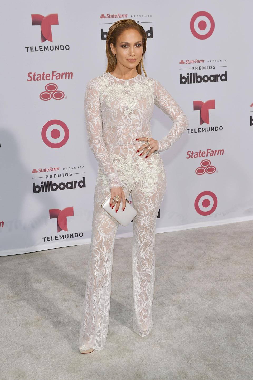 <p>Taking a break from maxi dresses never looked so good – we're a fan of this sheer pantsuit and begging for J.Lo to bring it back. [Photo: Getty] </p>