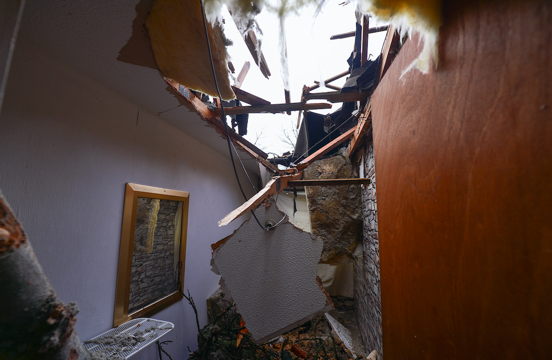 The tree smashed through one of the bedrooms in the house (Picture: SWNS)