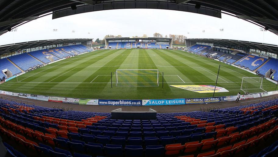Shrewsbury Town FC are about to take an unprecedented move as they are ​set to become the first club in English football to implement 'safe standing' at their stadium, Greenhous Meadow, according to a report in the ​BBC. They will look to introduce the safe standing area into the stadium before the close of the 2017/18 season as long as the initiative is approved by the authorities. The club, however, are confident that the project will be given the green light. Exclusive: Shrewsbury Town FC...
