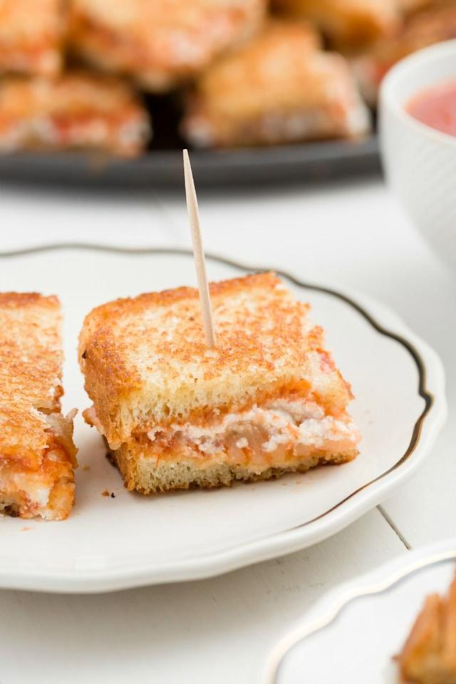"<p>It's two of your childhood favorites, together in one grab-and-go party snack that doesn't disappoint.</p><p>Get the recipe from <a href=""/cooking/recipe-ideas/recipes/a45286/lasagna-grilled-cheese-bites-recipe/"">Delish</a>.</p>"
