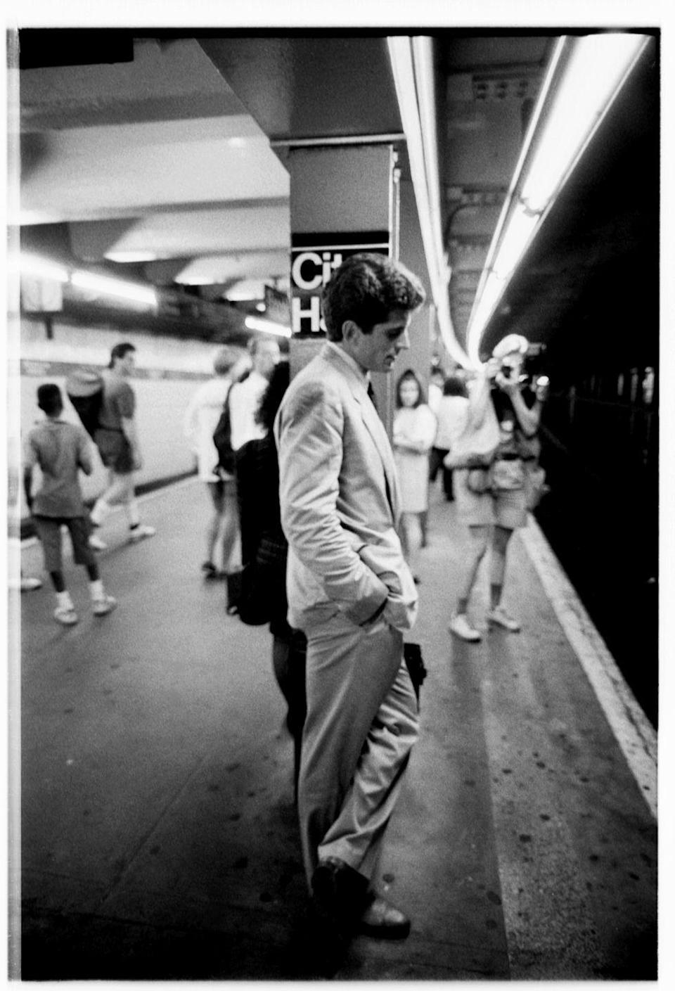 <p>John Kennedy Jr. waiting for the train at City Hall station on his first day as Assistant District Attorney. </p>