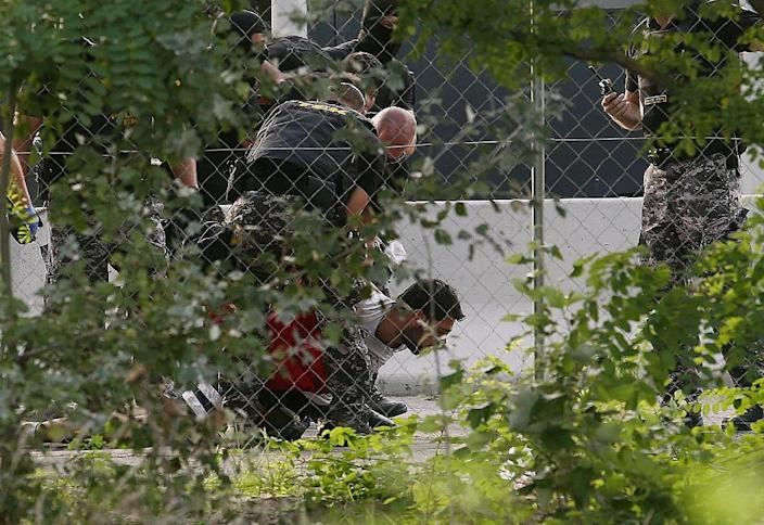 Hungary closed the razorwire-topped border while threatening three-year jail sentences against anyone who crosses illegally (AFP Photo/Sandor Gemesi)