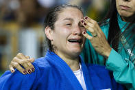 <p>Brazil's Maria Portela reacts after losing against Austria's Bernadette Graf during the women's 70-kg judo competition at at the 2016 Summer Olympics in Rio de Janeiro, Brazil, Wednesday, Aug. 10, 2016. (AP Photo/Markus Schreiber) </p>