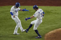 Los Angeles Dodgers' Cody Bellinger celebrates his two-run home run against the Tampa Bay Rays during the fourth inning in Game 1 of the baseball World Series Tuesday, Oct. 20, 2020, in Arlington, Texas. (AP Photo/Sue Ogrocki)