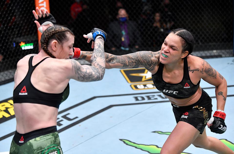 Amanda Nunes (right) retained her women's featherweight title in dominant fashionZuffa LLC via Getty Images