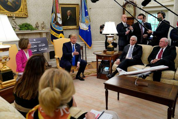 PHOTO: President Donald Trump speaks during a meeting with Gov. Kim Reynolds (R-Iowa) in the Oval Office of the White House in Washington, D.C., on May 6, 2020. Agriculture Secretary Sonny Perdue (right seated) and Vice President Mike Pence listen. (Evan Vucci/AP)