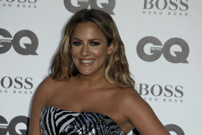 Tv Presenter Caroline Flack poses for photographers on arrival at the 'GQ Men of The Year' Awards, Wednesday, Sept. 5, 2018. (Photo by Grant Pollard/Invision/AP)