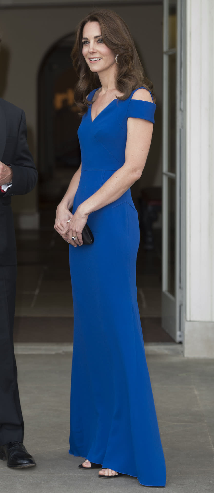 <p>For a Sports Aid gala at Kensington Palace, Kate wore a gorgeous royal blue Roland Mouret gown. Cartier hoop earrings, a black satin Prada clutch and Gianvito Rossi sandals topped off her stunning look.</p><p><i>[Photo: Getty]</i></p>