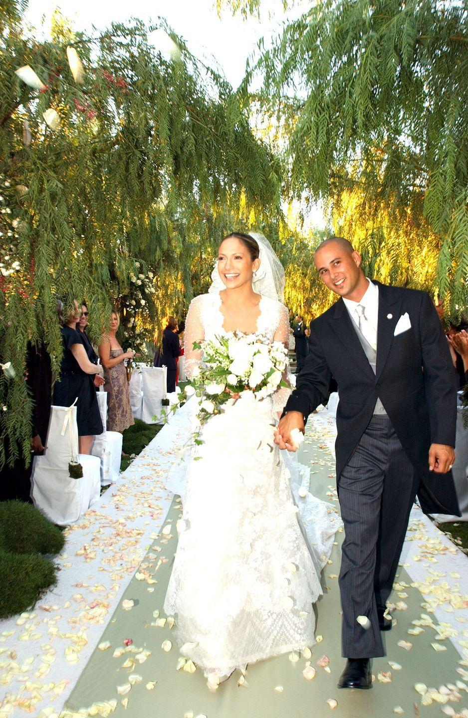 "<p>JLo's second wedding was a whirlwind. She married her backup dancer, Cris Judd, less than eight months after splitting from her boyfriend of two years, Sean Combs. Jennifer wore a Valentino gown and the duo put together their wedding plans in just <a href=""https://ew.com/article/2001/10/03/j-lo-says-i-do/"" rel=""nofollow noopener"" target=""_blank"" data-ylk=""slk:three months"" class=""link rapid-noclick-resp"">three months</a>.</p>"