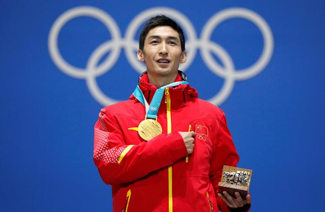 Medals Ceremony - Short Track Speed Skating Events - Pyeongchang 2018 Winter Olympics - Men's 500m - Medals Plaza - Pyeongchang, South Korea - February 23, 2018 - Gold medalist Wu Dajing of China on the podium. REUTERS/Eric Gaillard TPX IMAGES OF THE DAY