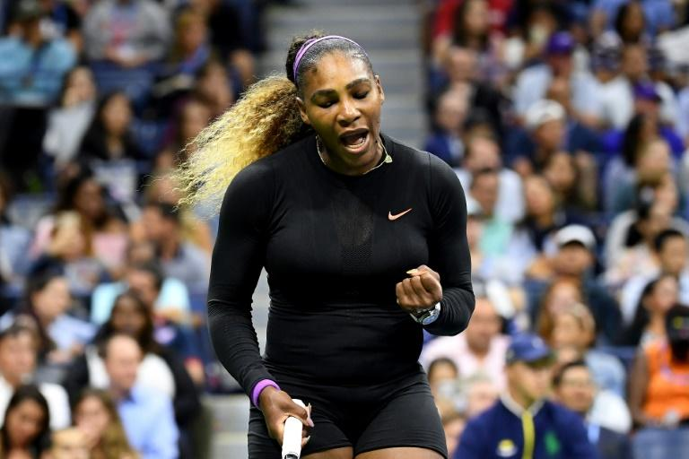 Serena Williams pumps her first after winning a point during her 6-1, 6-1 triumph over Maria Sharapova on Monday at the US Open