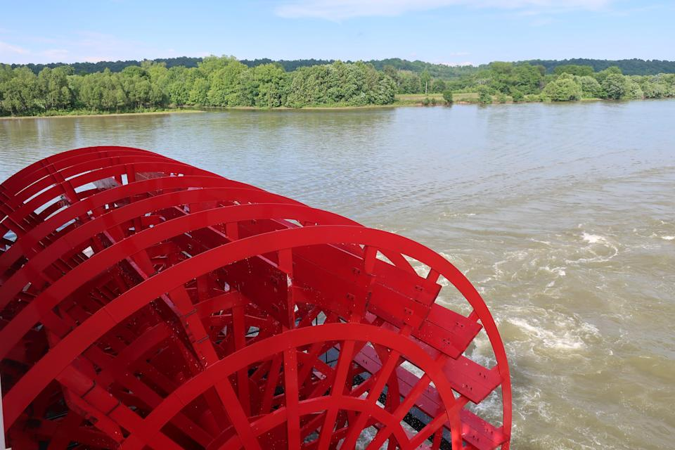 The American Duchess' paddlewheels help propel the boat up the Ohio River in Kentucky.