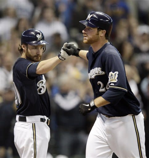 Milwaukee Brewers' Mat Gamel (24) is congratulated by Jonathan Lucroy after Gamel hit a home run during the second inning of a baseball game against the Los Angeles Dodgers Tuesday, April 17, 2012, in Milwaukee. (AP Photo/Morry Gash)
