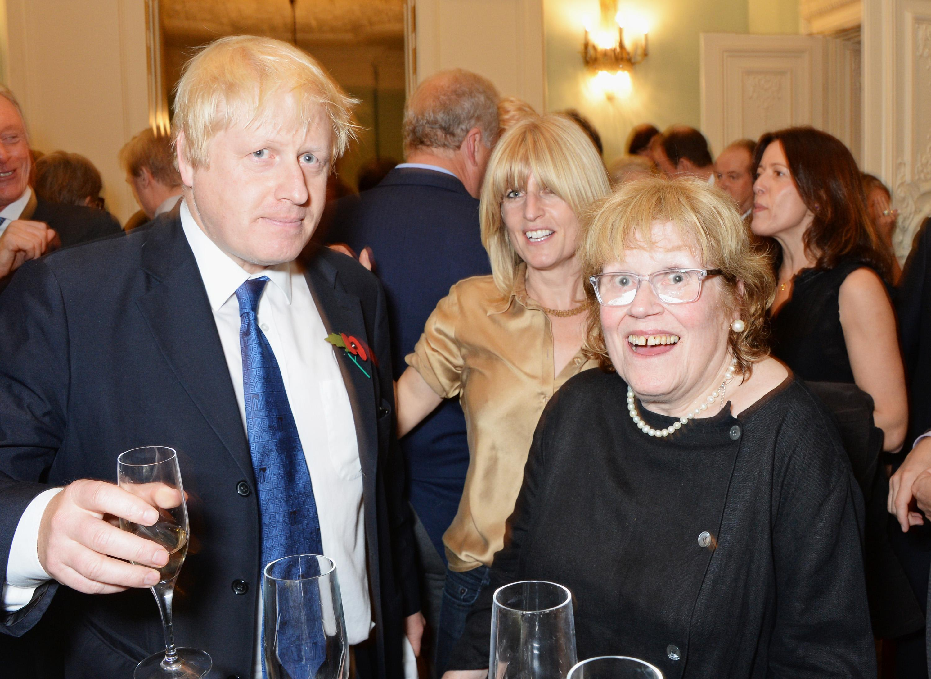"LONDON, ENGLAND - OCTOBER 22: (L to R) Mayor of London Boris Johnson, sister Rachel Johnson and mother Charlotte Johnson Wahl attend the launch of Boris Johnson's new book ""The Churchill Factor: How One Man Made History"" at Dartmouth House on October 22, 2014 in London, England. (Photo by David M. Benett/Getty Images)"