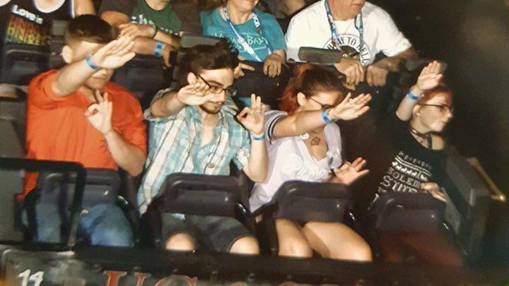 "Four people riding the Revenge of the Mummy roller coaster at Universal Studios Orlando performed the Nazi and ""OK"" symbols. (Photo: Reddit)"
