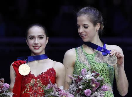 Figure Skating - ISU European Championships 2018 - Ladies' Victory Ceremony - Moscow, Russia - January 20, 2018 - Gold medallist Alina Zagitova of Russia (L) and bronze medallist Carolina Kostner of Italy attend the ceremony. REUTERS/Grigory Dukor
