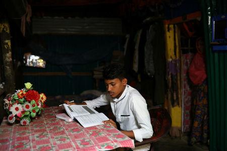 Kefayat Ullah, a Rohingya boy who was expelled from Leda High School for being a Rohingya, studies in his shelter in Leda camp in Teknaf