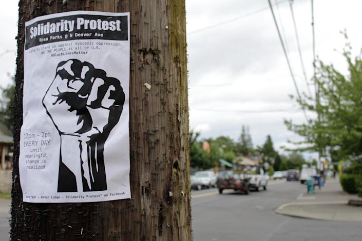 A sign advertising a daily protest in solidarity with Black Lives Matter is affixed to a telephone pole in a historically Black neighborhood in Portland, Ore., on July 1 2020.