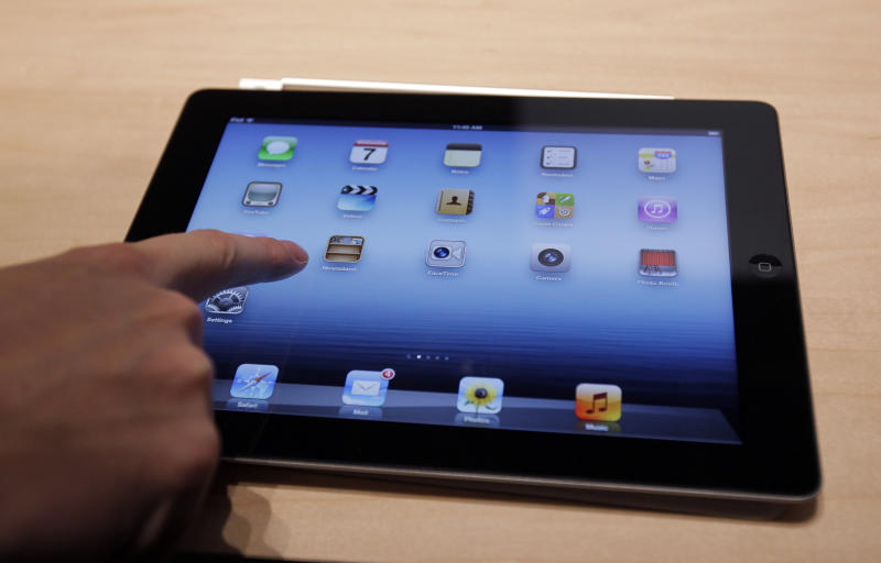 A new Apple iPad on display during an Apple event in San Francisco, Wednesday, March 7, 2012.  The new iPad model features a sharper screen and a faster processor.  Apple says the new display will be even sharper than the high-definition television set in the living room.   (AP Photo/Paul Sakuma)