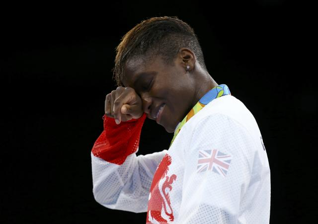 2016 Rio Olympics - Boxing - Victory Ceremony - Women's Fly (51kg) Victory Ceremony - Riocentro - Pavilion 6 - Rio de Janeiro, Brazil - 20/08/2016. Gold medallist Nicola Adams (GBR) of Britain reacts. REUTERS/Peter Cziborra TPX IMAGES OF THE DAY. FOR EDITORIAL USE ONLY. NOT FOR SALE FOR MARKETING OR ADVERTISING CAMPAIGNS.