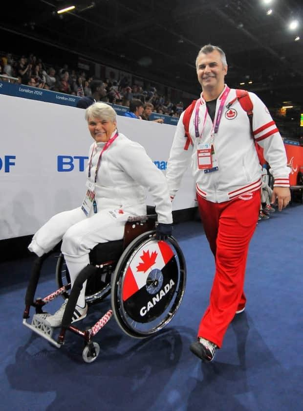 Sylvie Morel, seen above with national-team coach Iulian Badea at London 2012, says she isn't ready to retire from the Paralympics just yet. (Courtesy Canadian Paralympic Committee - image credit)
