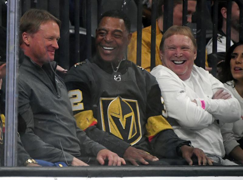 LAS VEGAS, NEVADA - FEBRUARY 13: (L-R) Las Vegas Raiders head coach Jon Gruden, Pro Football Hall of Fame member and former Raider Marcus Allen and Raiders owner and managing general partner Mark Davis attend a game between the St. Louis Blues and the Vegas Golden Knights at T-Mobile Arena on February 13, 2020 in Las Vegas, Nevada. The Golden Knights defeated the Blues 6-5 in overtime. (Photo by Ethan Miller/Getty Images)